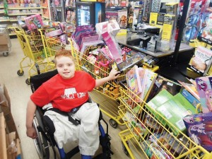 B.J. with a train of shopping carts filled with toys for patients at Riley Hospital for Children.