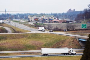 Traffic streams along the bustling Interstate 64/Indiana 162 interchange on the southern fringe of Ferdinand. Southern Indiana Power, an electric cooperative, once served the area surrounding the interchange until the town annexed the corridor to the interstate before it developed. Ferdinand's municipal electric utility took over service. The town left a farmhouse, just to the west, out of the annexation which the co-op still serves.