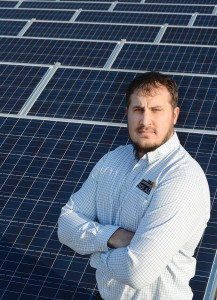 Jason Monroe, energy management supervisor at Tipmont REMC, stands in front of Tipmont's community solar farm — the first in Indiana. Tipmont took advantage of economies of scale and photovoltaic pricing that has fallen 70 percent since 2010 to build the array and offer shares of its generation to consumers who want to support green energy at competitive pricing.