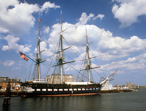 """The USS Constitution rests in its home port at Charlestown Navy Yard in Boston (1996 photo). The world's oldest commissioned warship afloat, launched in 1797 and made famous by its exploits in the War of 1812 when it earned the nickname """"Old Ironsides"""", is scheduled to enter dry dock this month for a three-year restoration. New planking for the hull comes exclusively from massive white oak timber reserved just for the Constitution growing naturally at the Crane naval base in south central Indiana."""