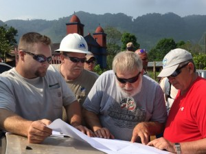 Before working on a stretch of line, Indiana lineworkers double check a staking sheet.