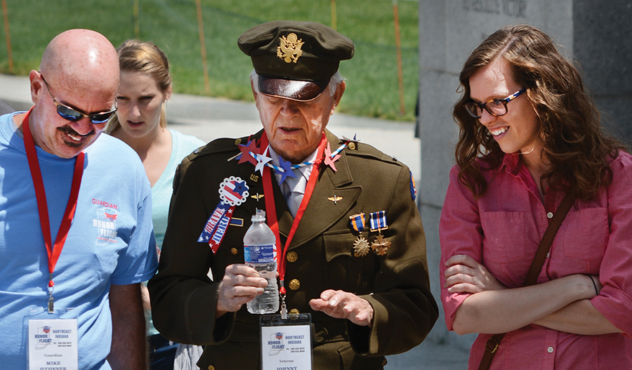 11:58 am: (left) Johnny Smiley, center, talks about his experiences during World War II with his Honor Flight guardian Mike O'Conner and daughter Carlie O'Conner at the World War II Memorial. Smiley, 91, of Oakford, who wore his uniform throughout the day, was a B-17 bomber pilot during World War II. Carlie met the group at the memorial; the Kokomo native is working on her doctorate in D.C.