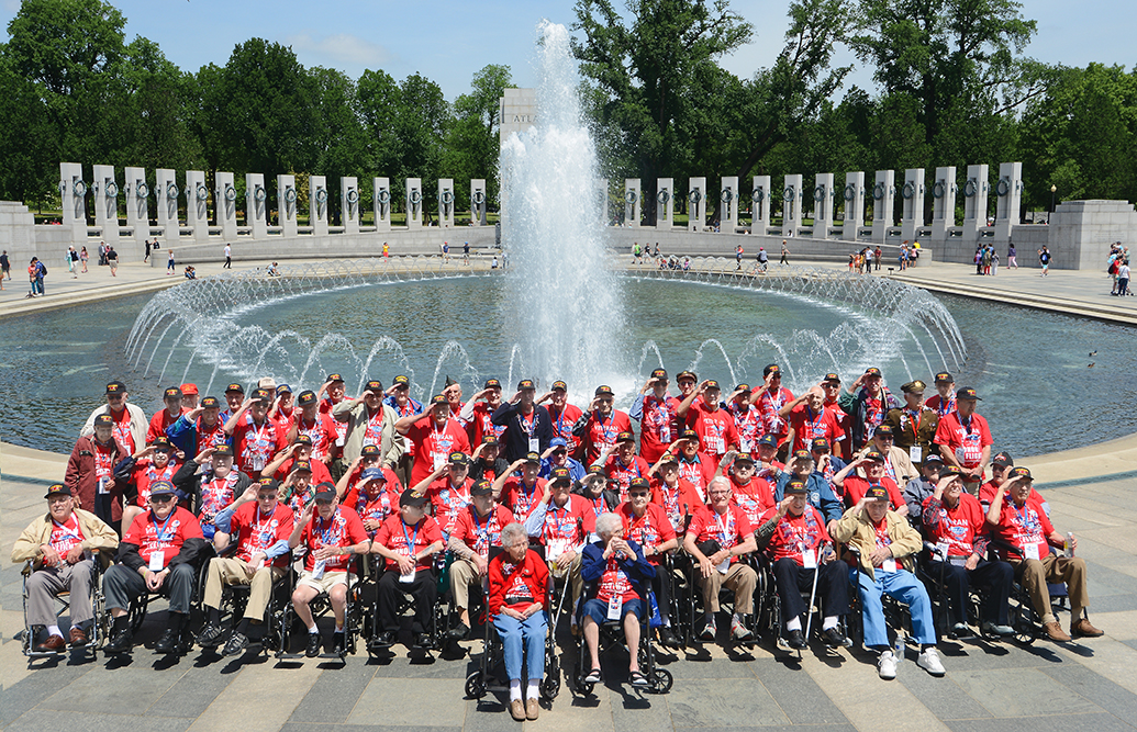 """12:18 pm: The 70 veterans on Honor Flight Northeast Indiana's 16th flight May 20 gather for a group photo at the World War II Memorial. The group included two women — Polly Lipscomb, front row left, who was a first lieutenant in the Army Nurse Corps and Betty """"Junebug"""" Harshman, front row right, who was a seaman, first class, in the Navy WAVES."""