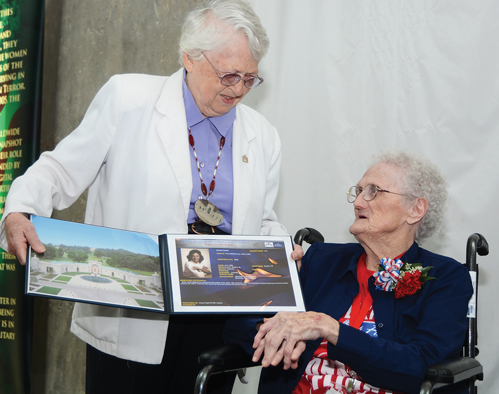 """3:04 pm: Betty """"Junebug"""" Harshman, 91, receives a special presentation from retired U.S. Air Force Brig. Gen. Wilma L. Vaught at the Women In Military Service For America Memorial to recognize her service in the Navy WAVES. A presentation was also made to Polly Lipscomb. The memorial is at the entrance to Arlington National Cemetery."""