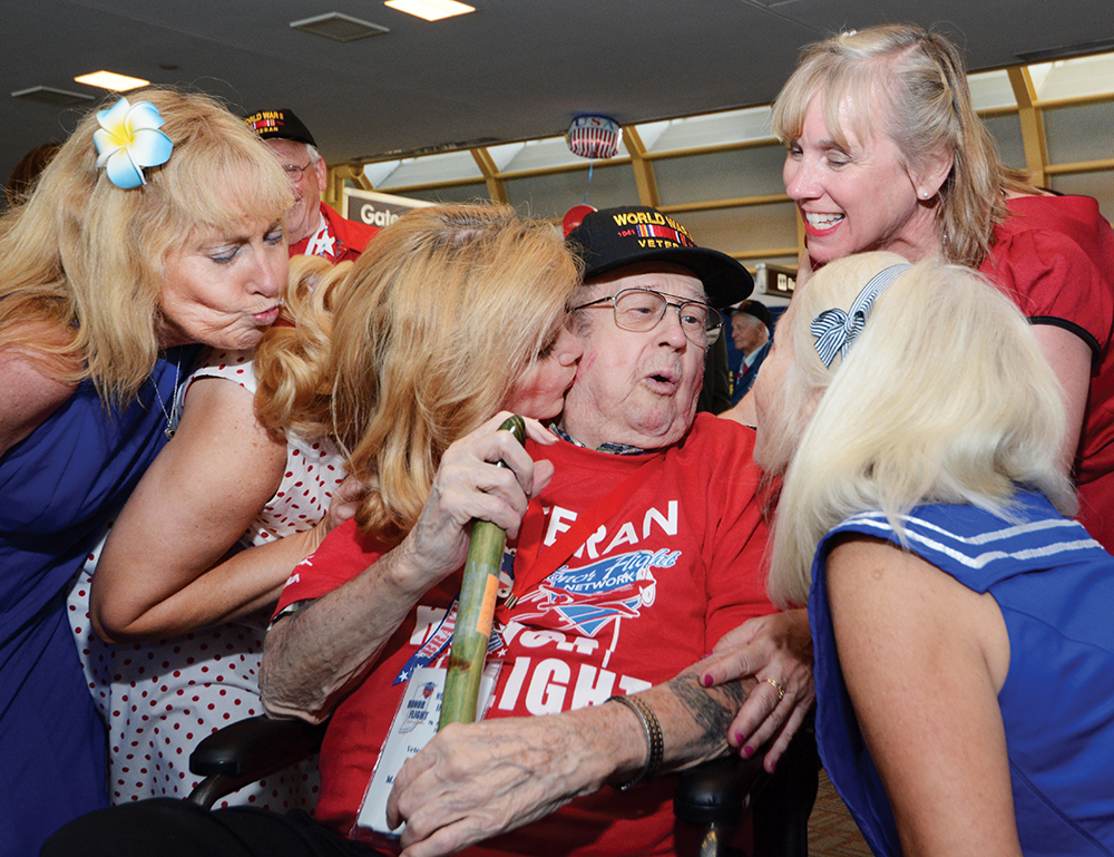 6:46 pm: Veteran Dick Martz has his hands full as the dancers move in for smooches which leave red lipstick on his cheeks.