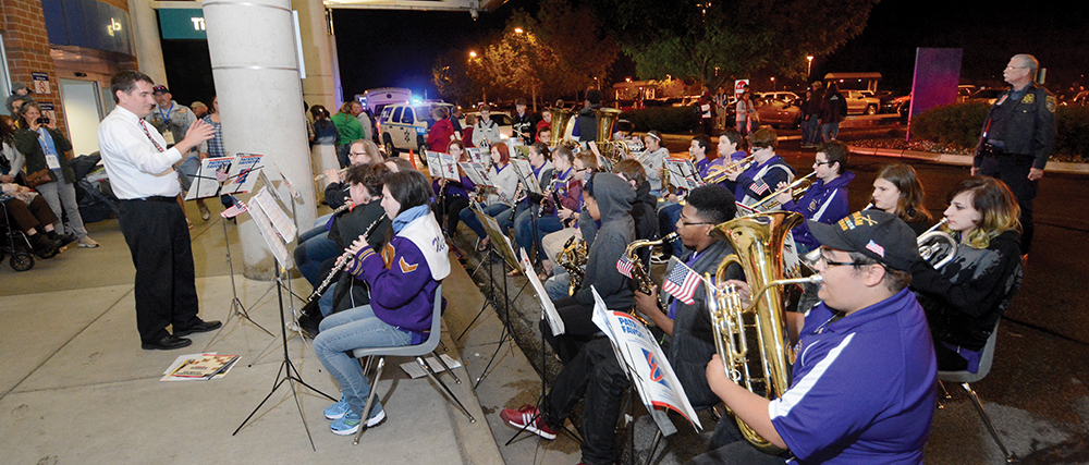 10:19 pm: On what became a cool rainy night, members of the New Haven High School band cap off the long day with patriotic songs to bid the veterans farewell as Honor Flight participants and their families head home from the Fort Wayne airport.