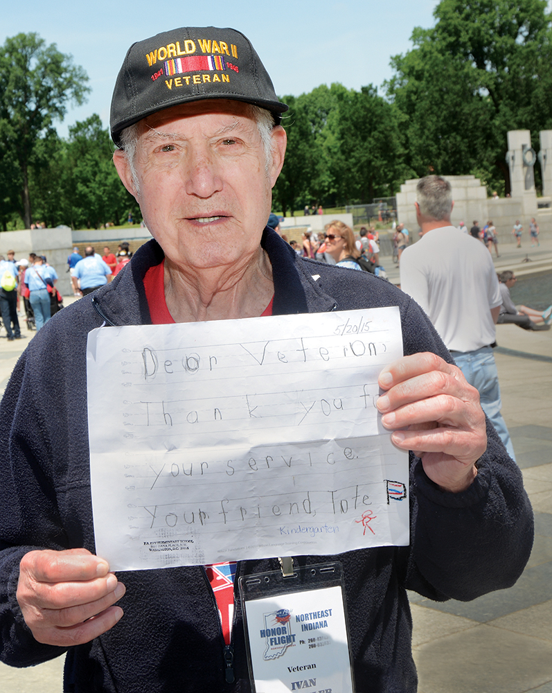 """Amid the majestic stone and metalwork of the World War II Memorial, Fort Wayne veteran Ivan Detwiler seems most moved by a simple letter handed to him when the flight arrived at Reagan airport. The letter reads: """"Dear Veteran, Thank you for your service. Your friend, Tate."""" Tate Butler is a kindergartner from Francis Scott Key Elementary in Washington."""