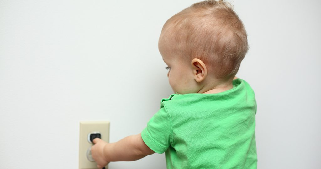 Baby playing with outlet