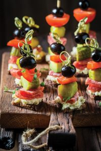 Homemade various cold snacks with vegetables and herbs for party