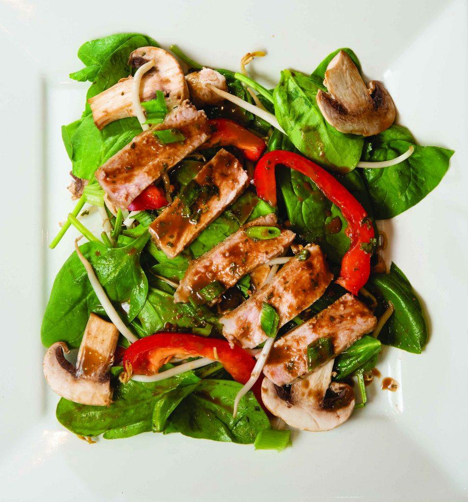 Oriental Pork Chops on Spinach with Thai Peanut Dressing