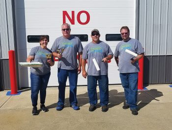 Decatur County REMC employees performing a community service project by painting