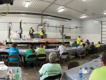 Employees performing a safety demonstration for Kankakee Valley REMC safety day