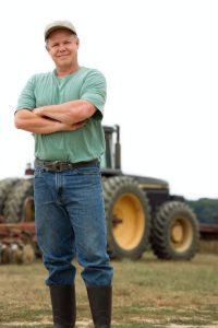 Farmer in front of tractor