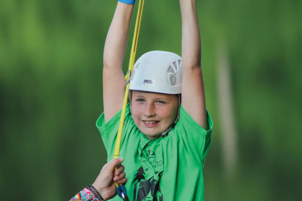 Girl ziplining at camp