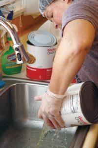 Volunteer helps prepare a meal