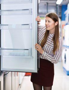 Person looking into a refridgerator