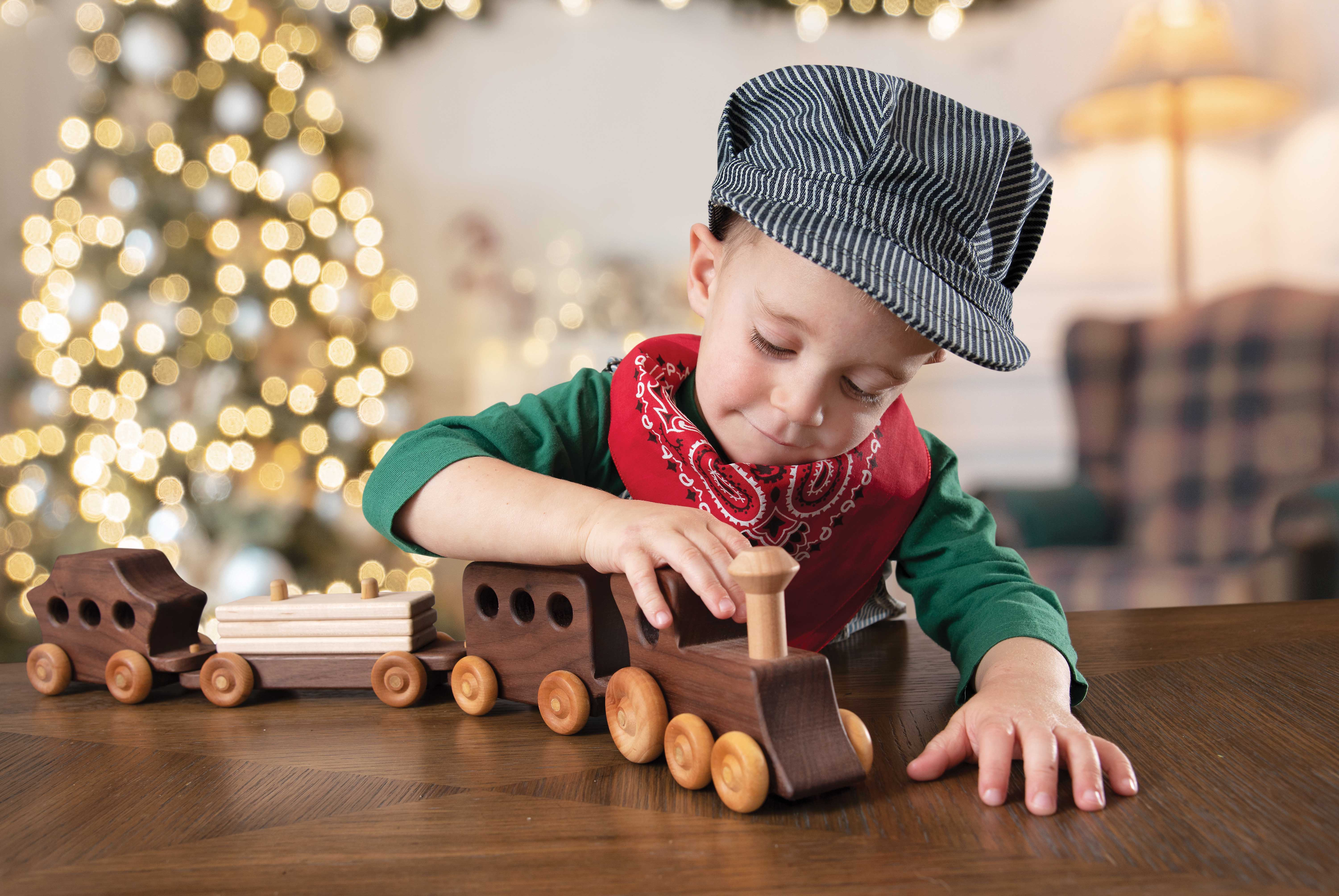 Boy playing with a toy train