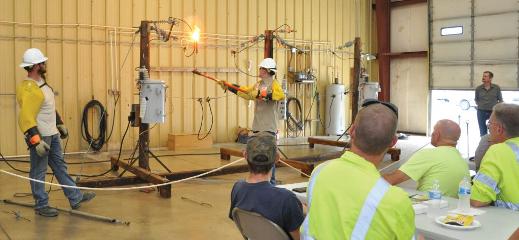 Noble REMC linemen conducting a live wire demonstration