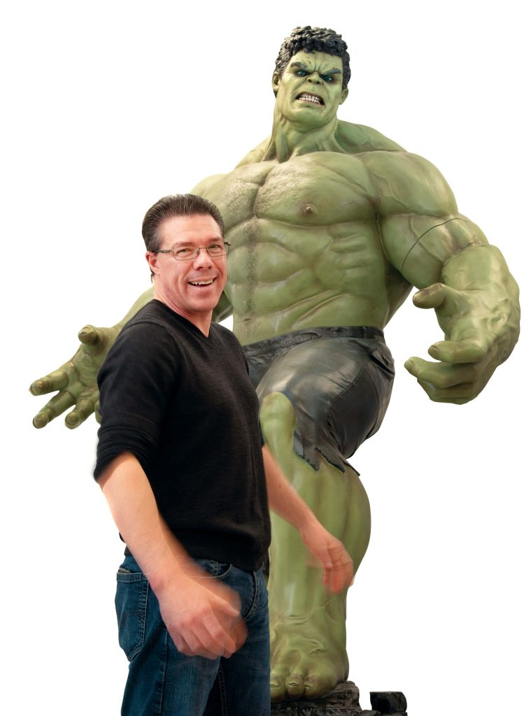 Hall of Heroes Museum Director Allen Stewart with cutout of Hulk