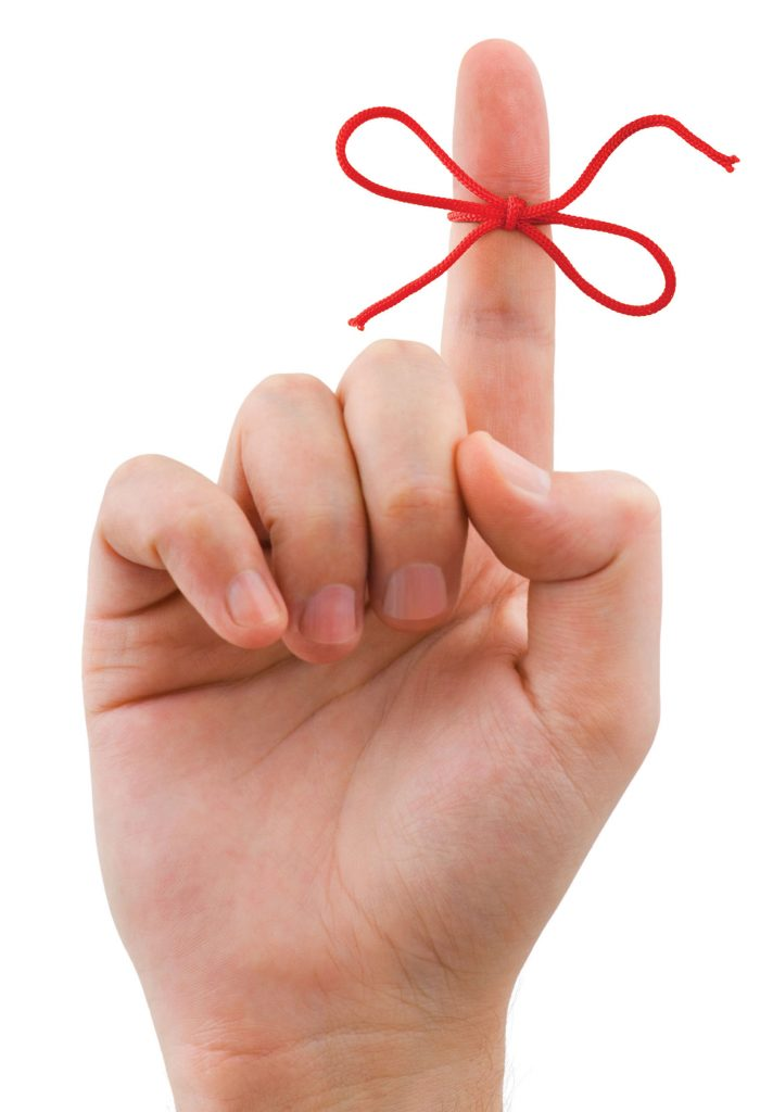 Photo of finger with ribbon around it.