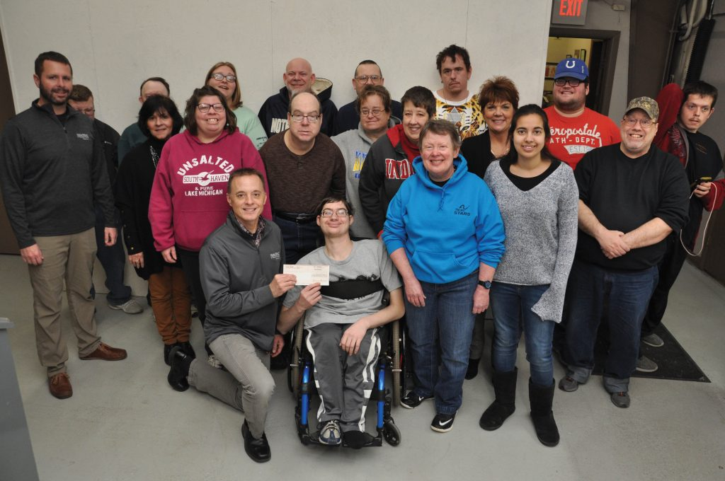 Photo of Noble REMC staff and The Arc Noble County Foundations members