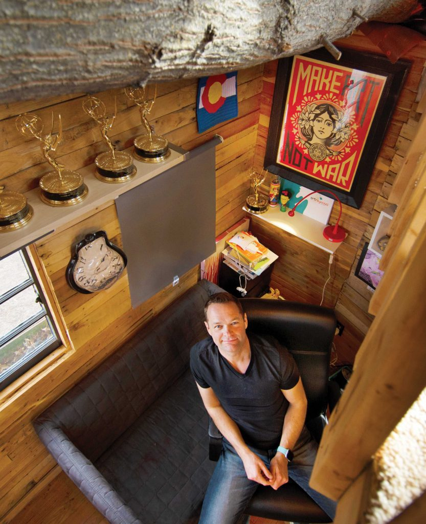 Photo of Nate Heck in his treehouse