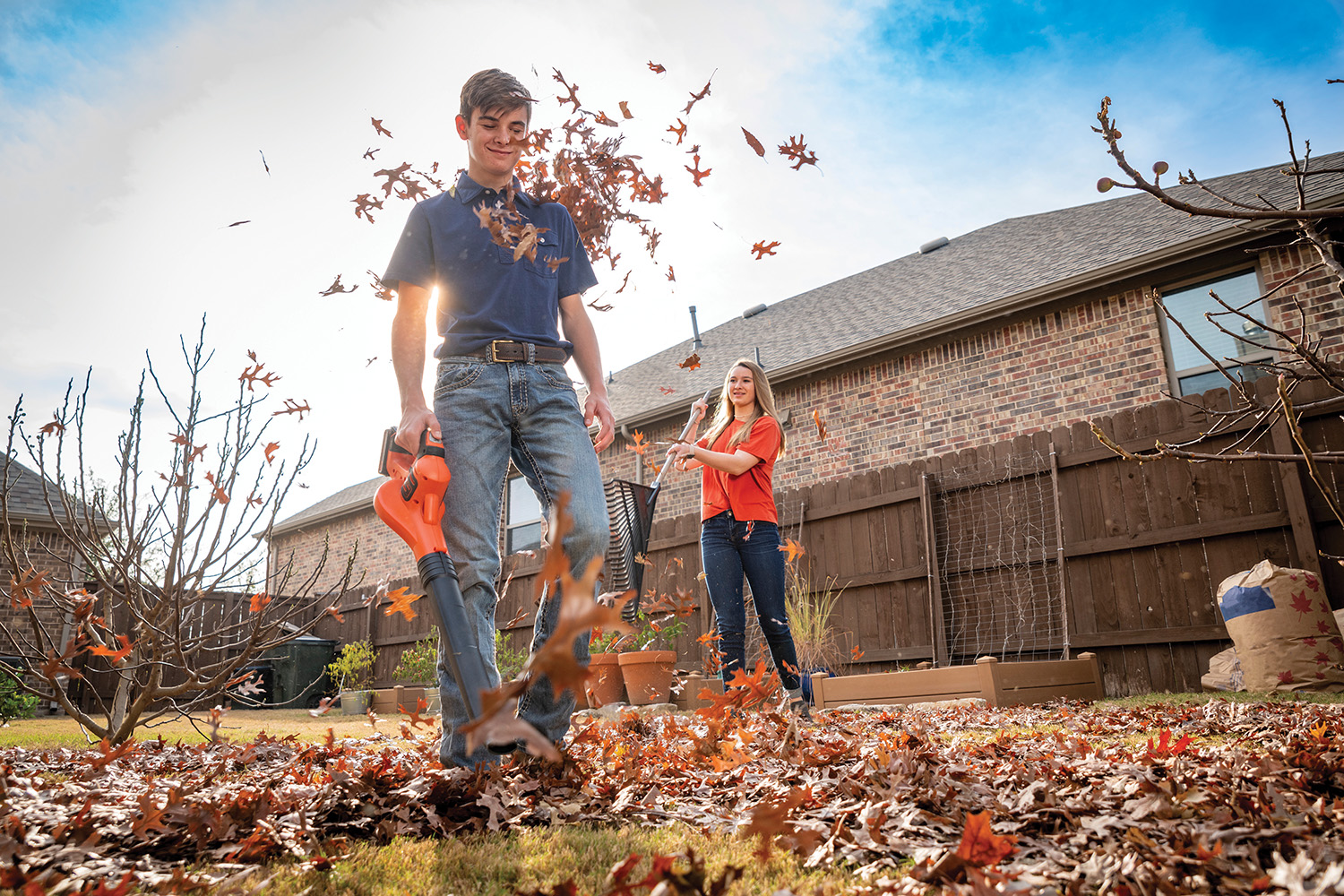 Photo of young man with leaf blower
