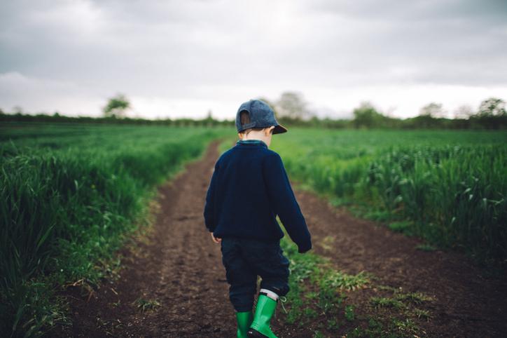 Boy in farm field