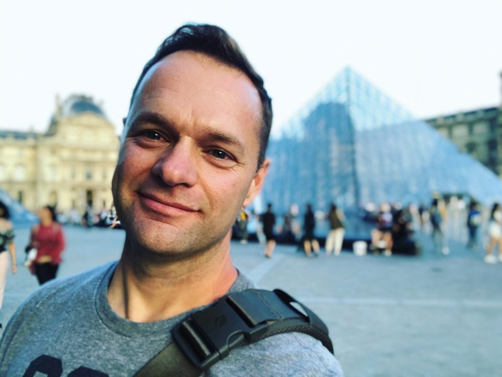 Nate Heck in front of the Louvre in Paris.