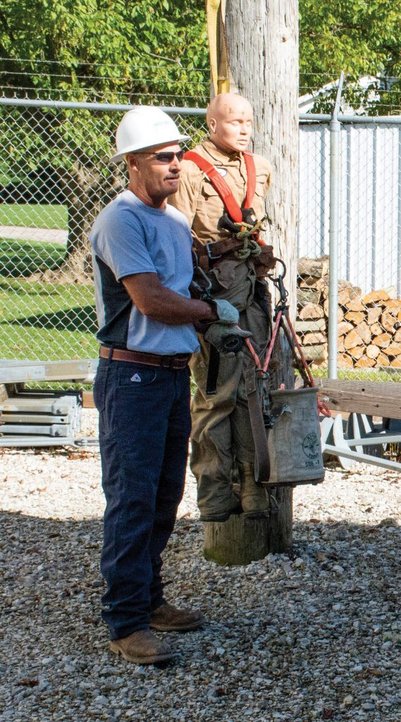 Photo of lineman Dave Helton teaching a training class.
