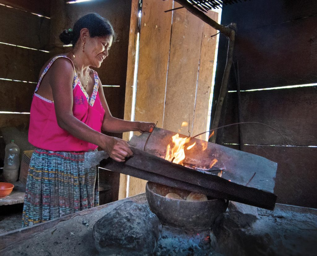 Photo of Hilaria Chub cooking in her kitchen in Guatemala.