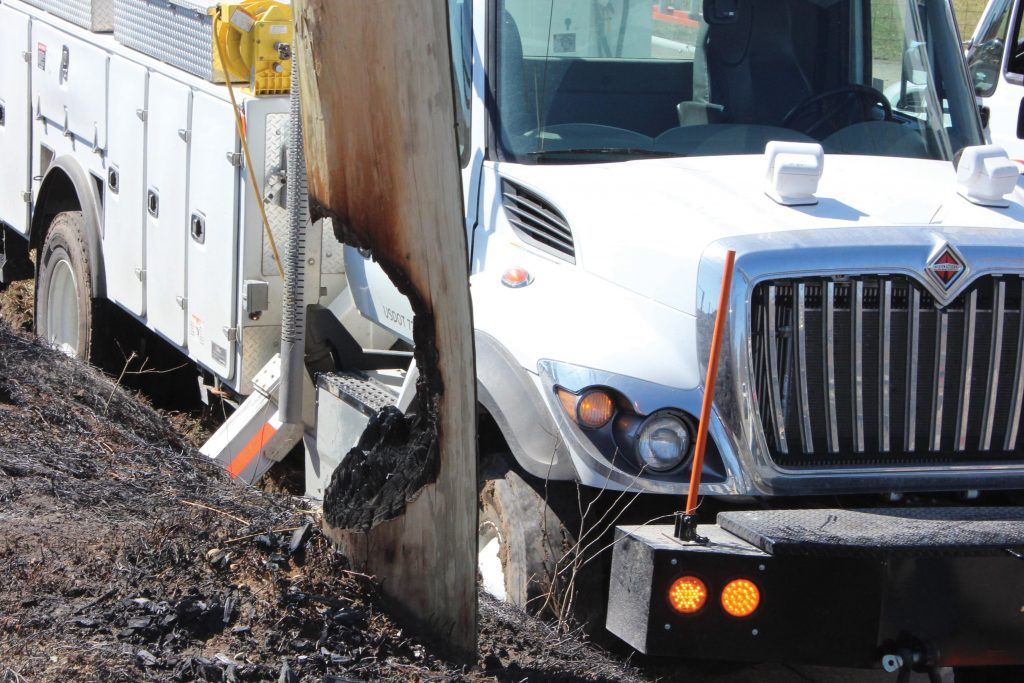 Photo of burnt pole and utility truck