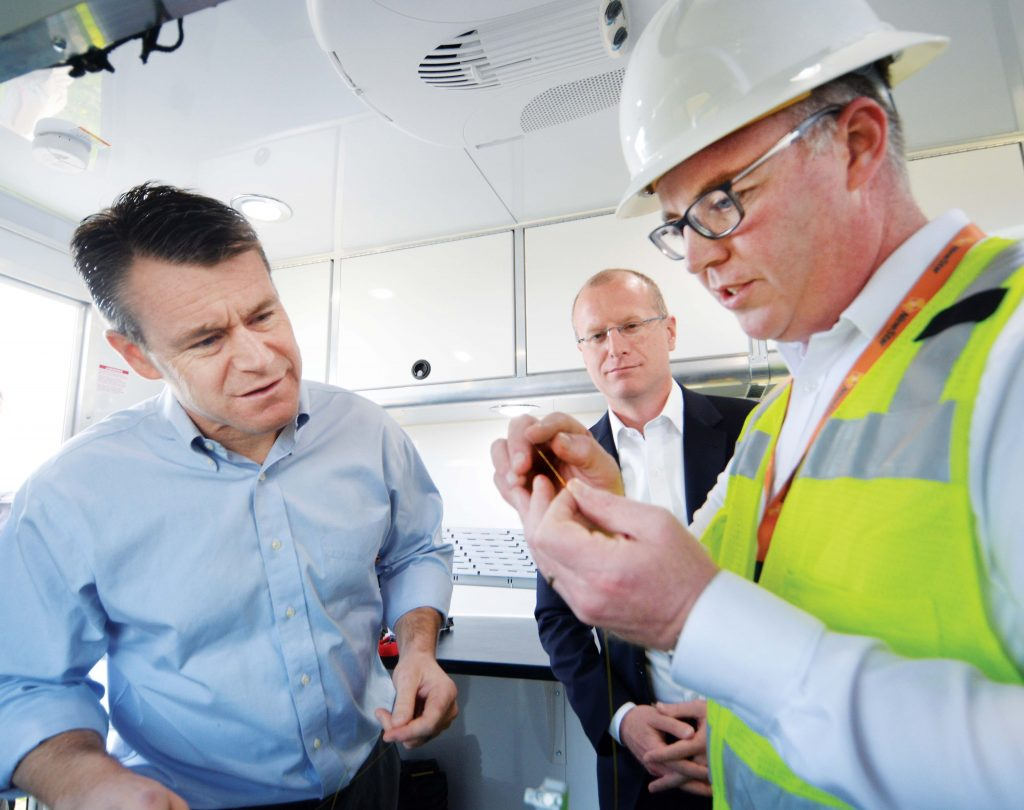 Photo of Sen. Todd Young with others during a visit to NineStar Connect.