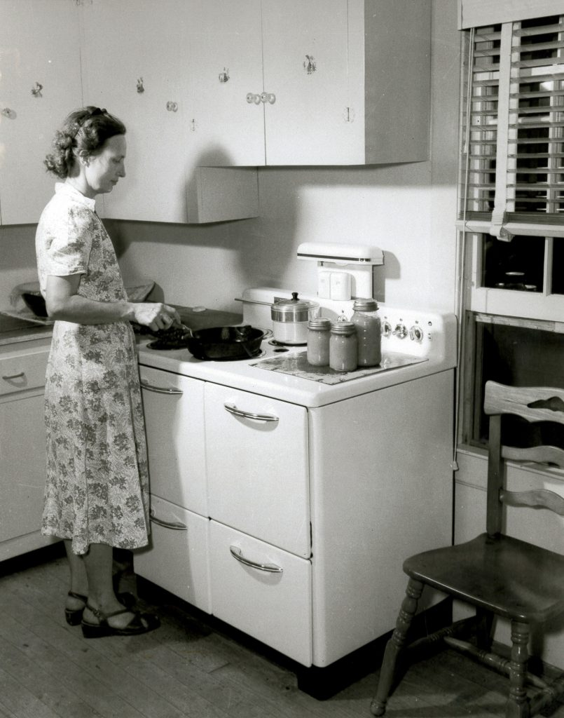 Woman cooking on electric stove