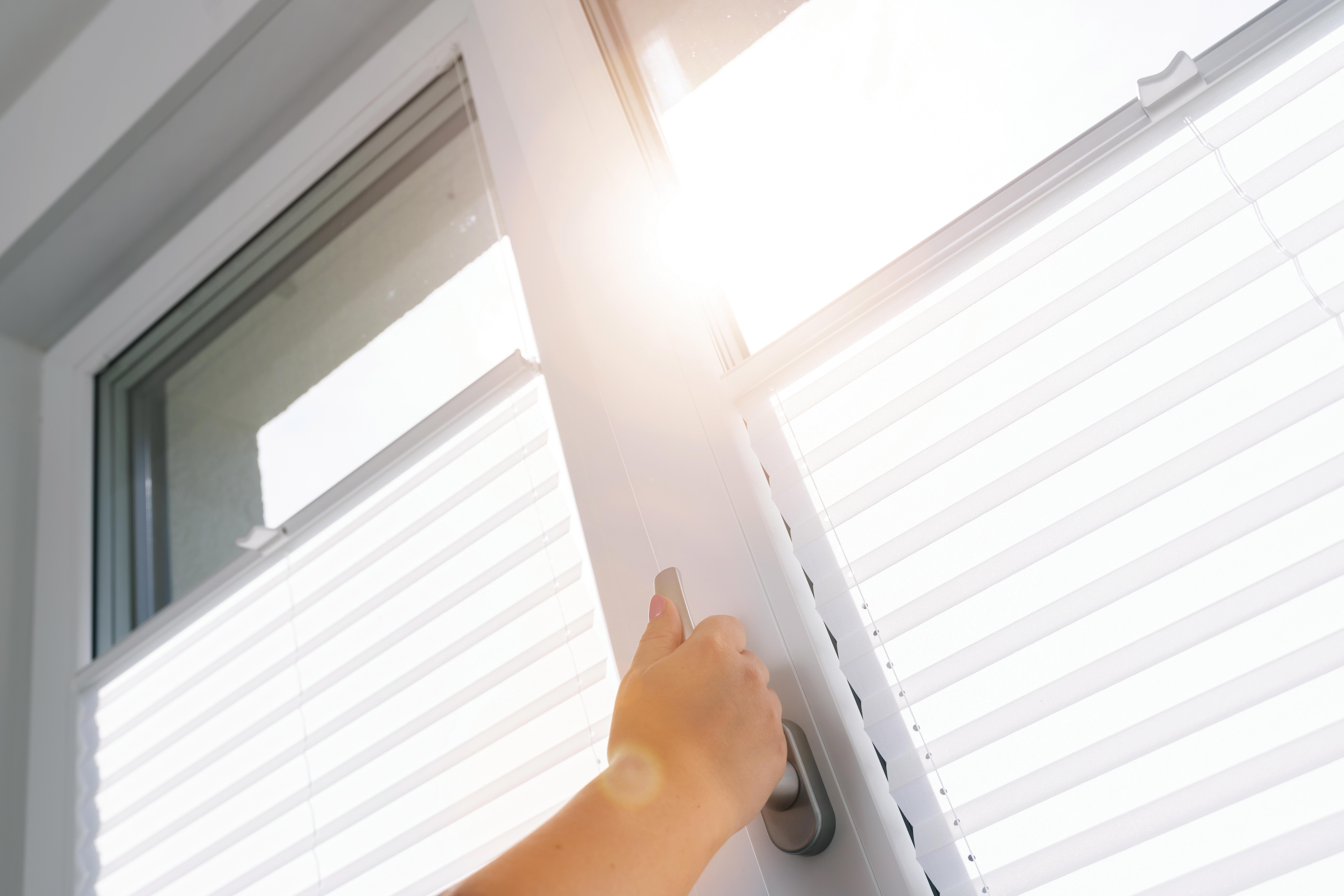 Photo of person opening windows