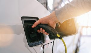Person plugging in an electric car