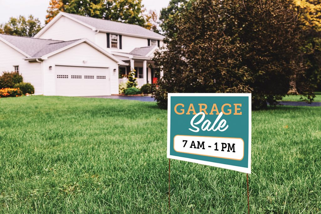 Photo of house with garage sale sign