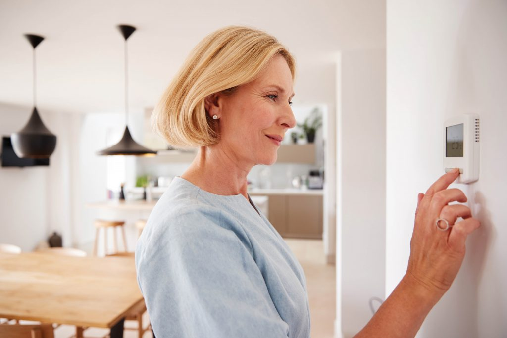Woman at thermostat