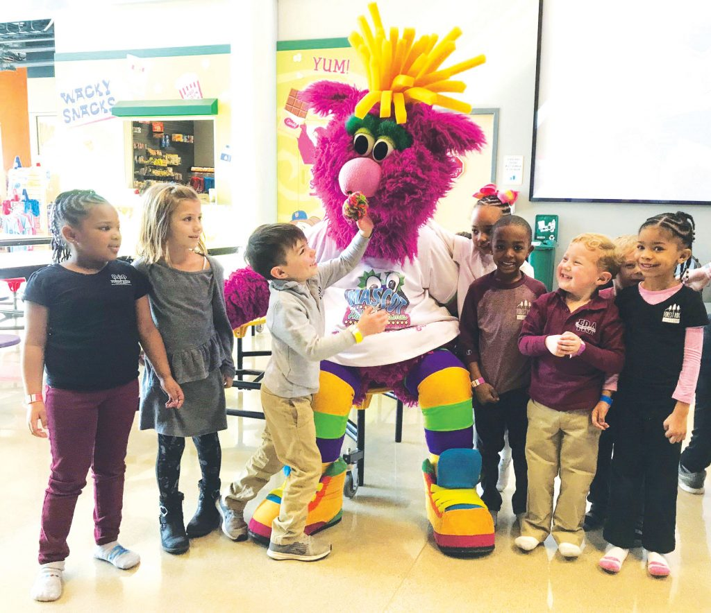 Kids with an unidentified mascot
