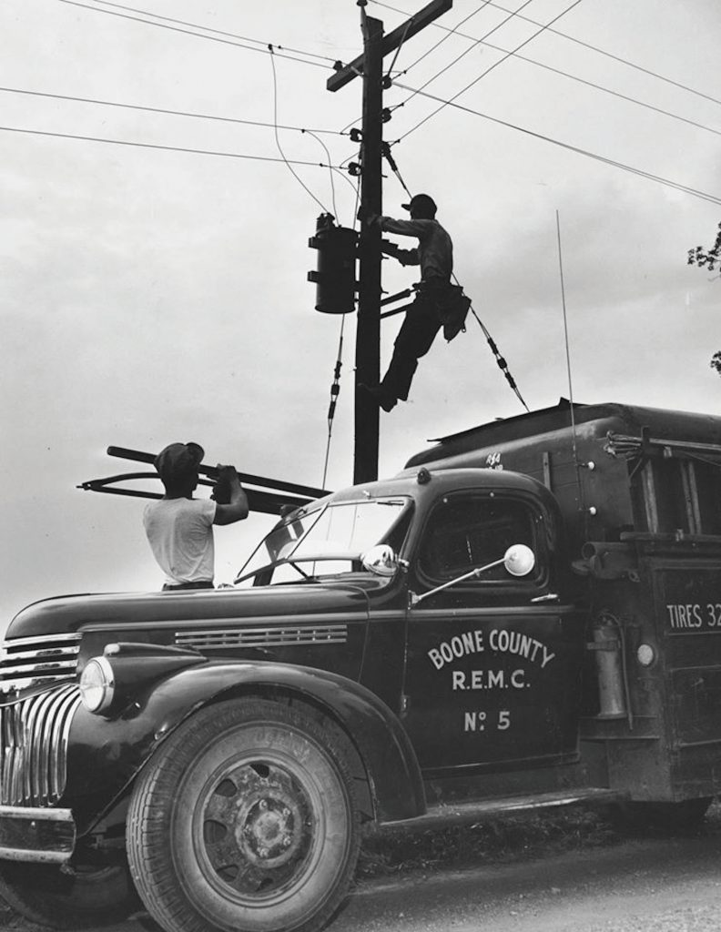Photo of lineman at Boone REMC in early days