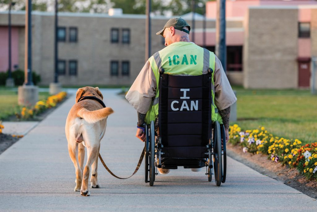 Man in wheelchair with dog