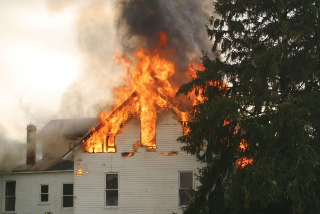 Photo of house on fire