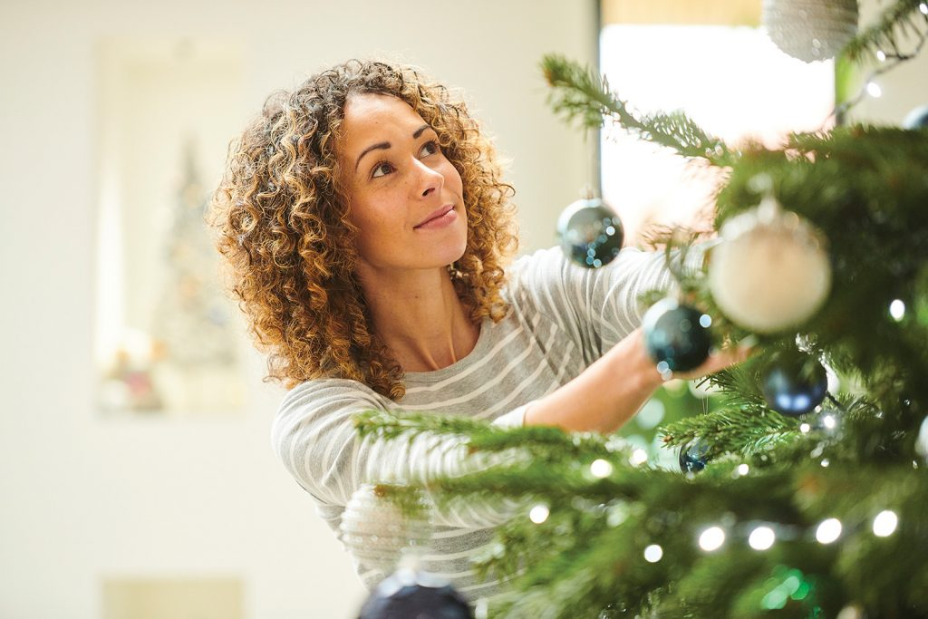 Lady decorating a tree
