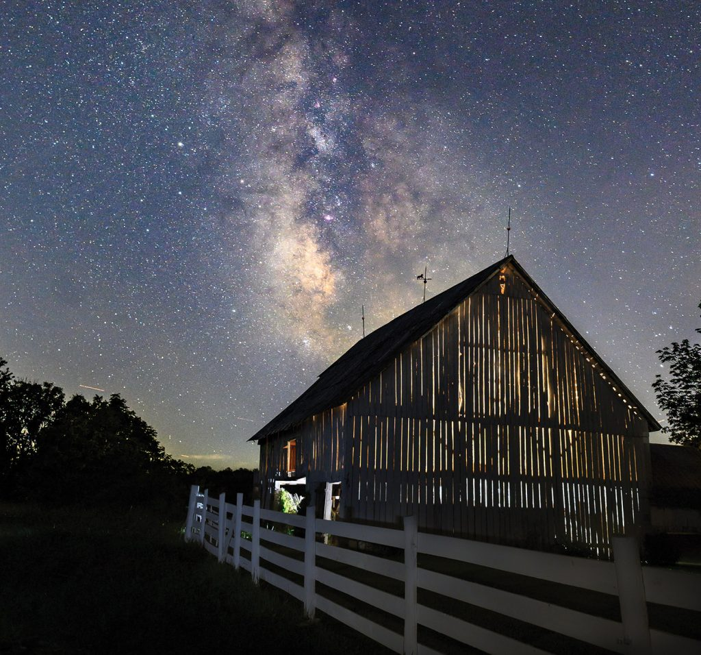 Barn in Monroe County against a stary backdrop