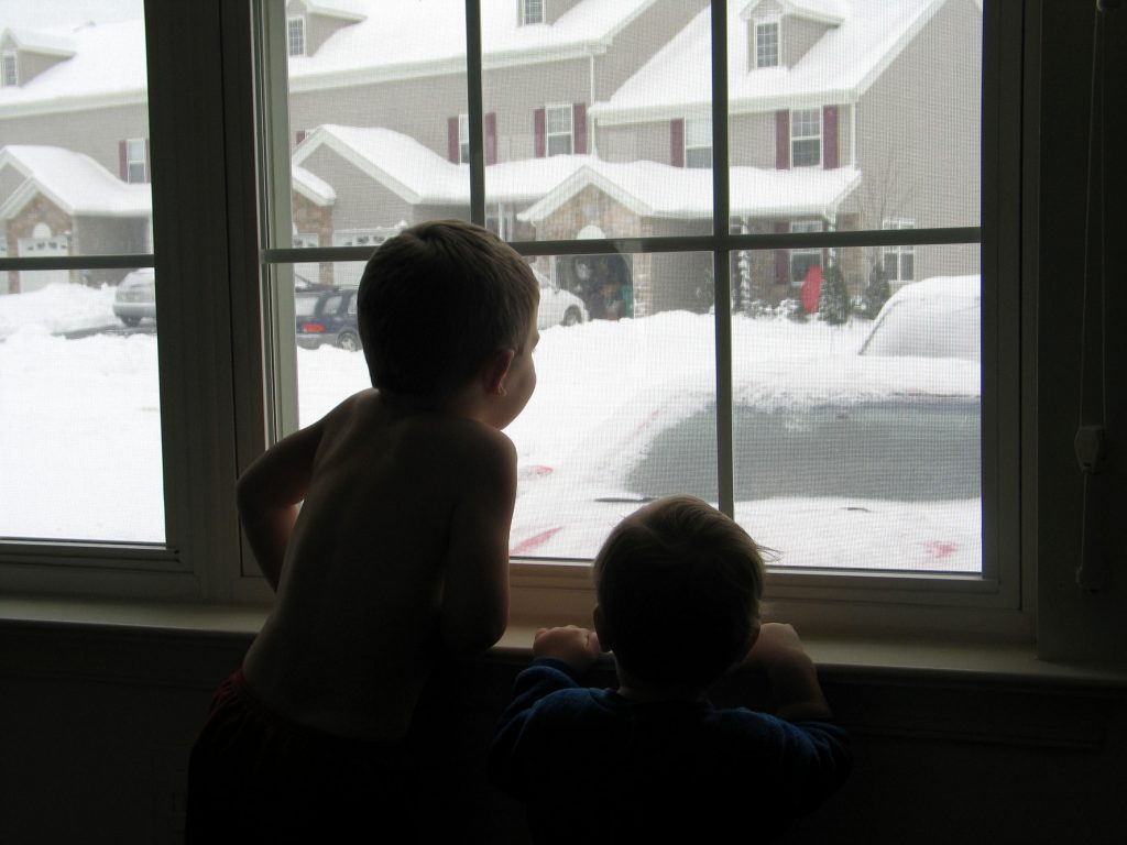 Children looking out at snow