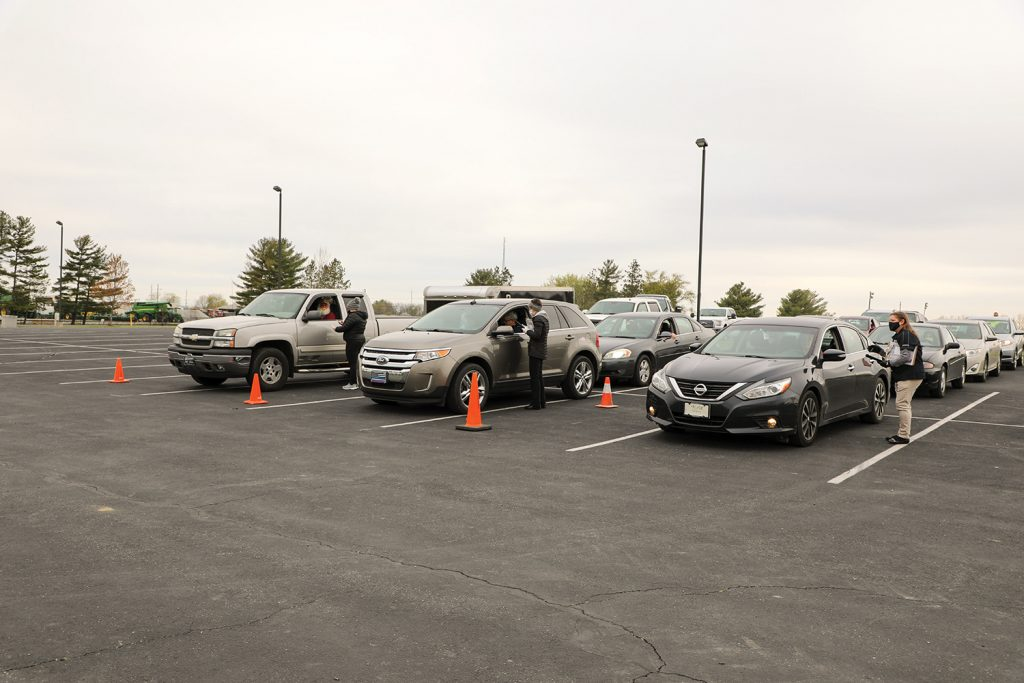 Employees registering vehicles at annual meeting