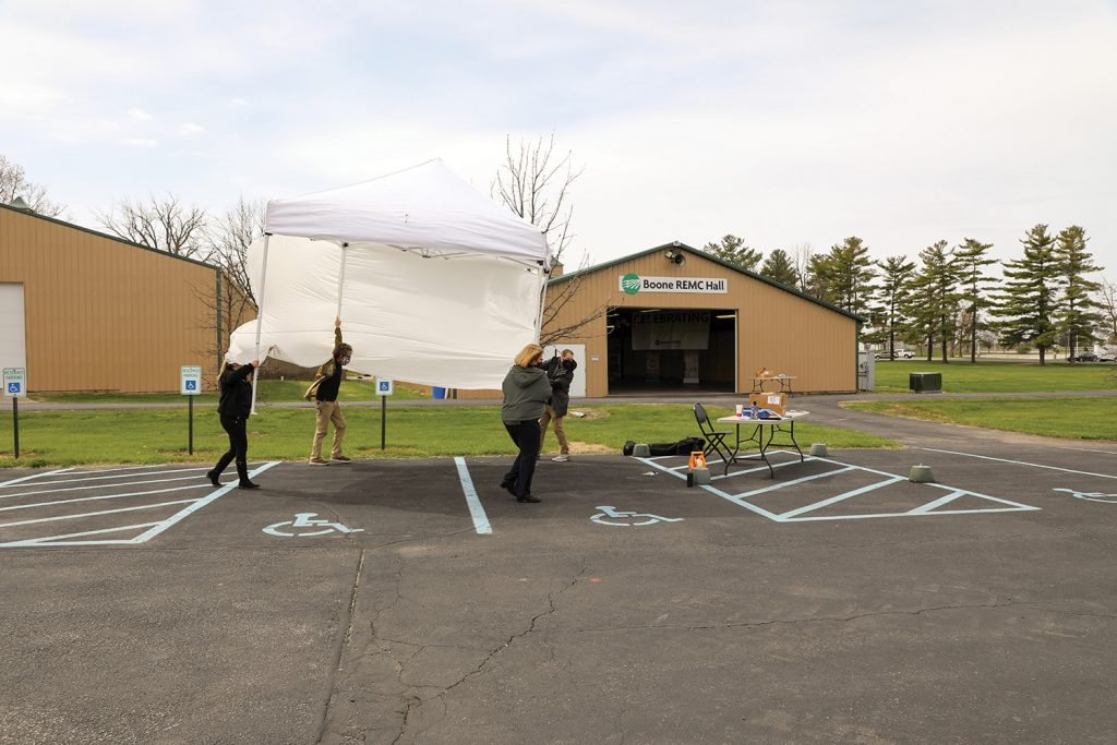 Staff putting up a tent