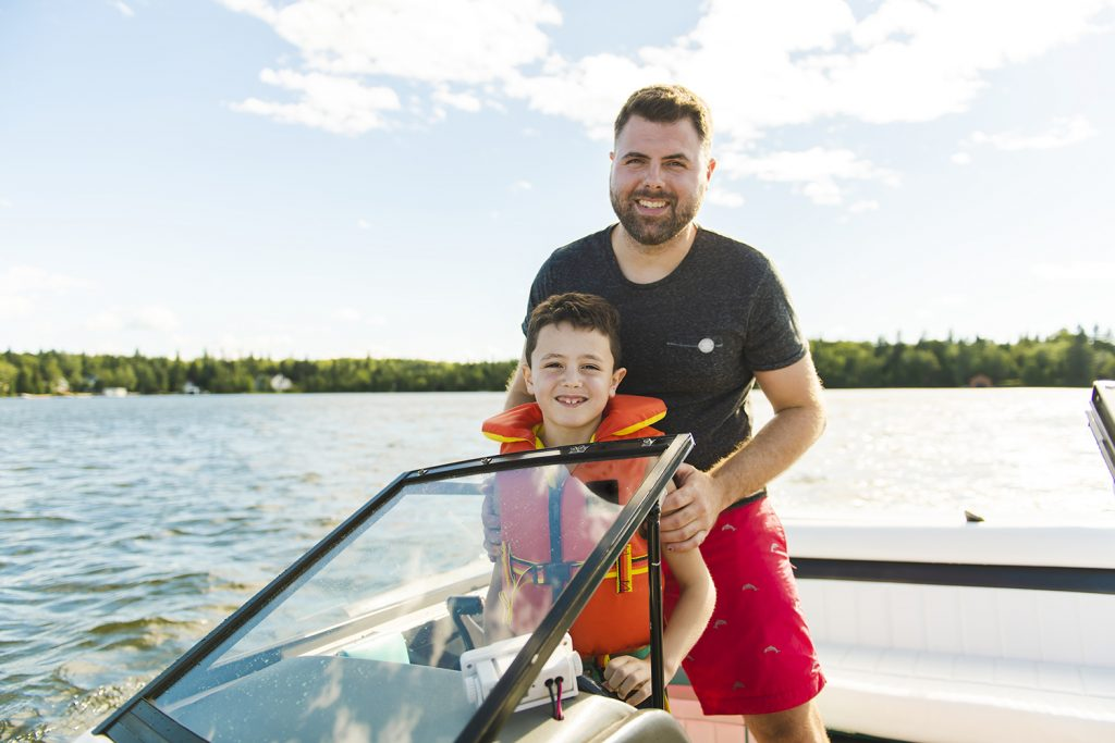 Father boating with son