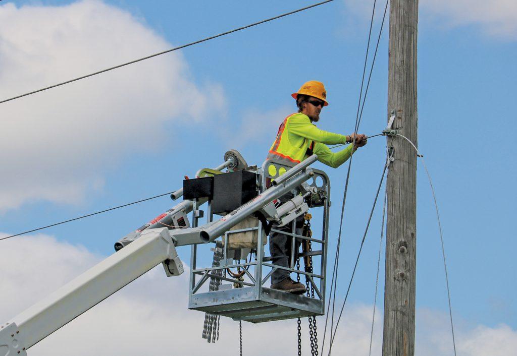 Worker on utility pole