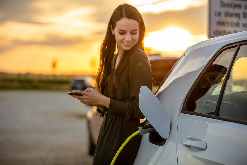 Woman with electric vehicle
